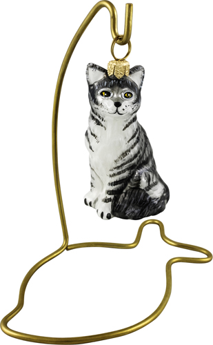 Brass fish ornament stand for cat ornaments.